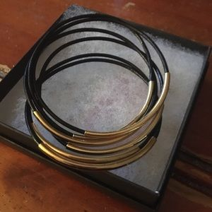 6 leather and gold tone bracelets.